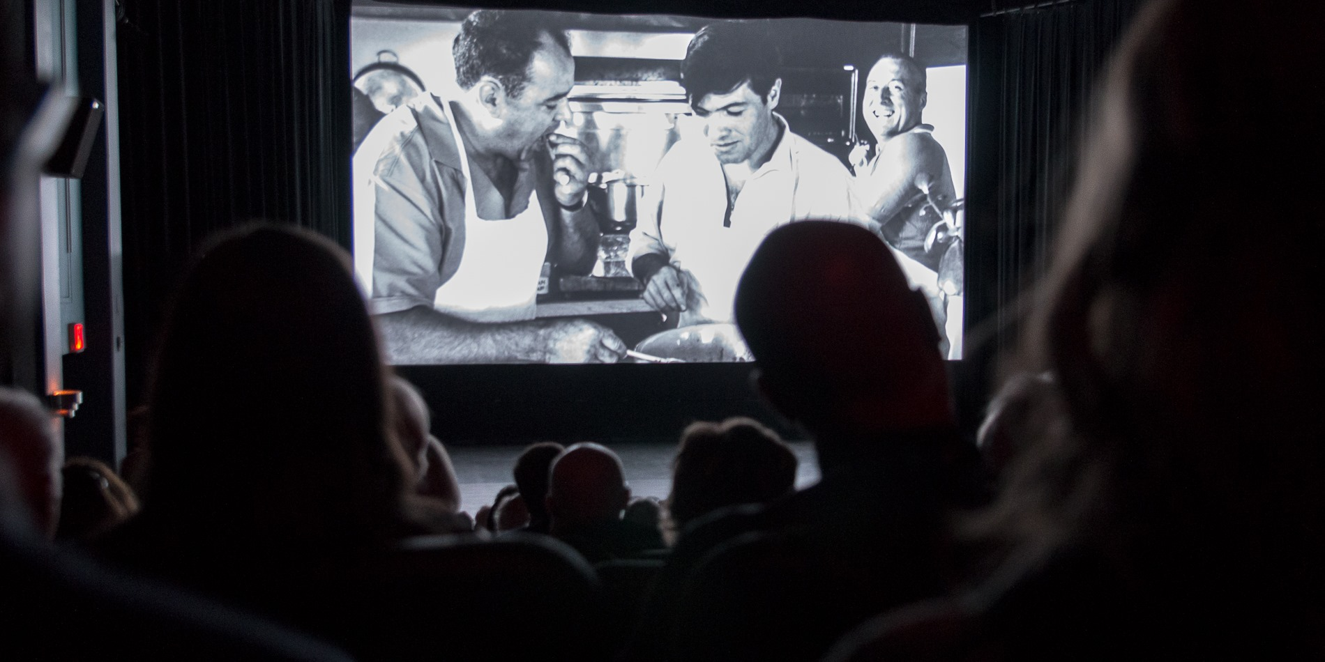 People watching a film in a theatre during Devour! The Food Film Fest