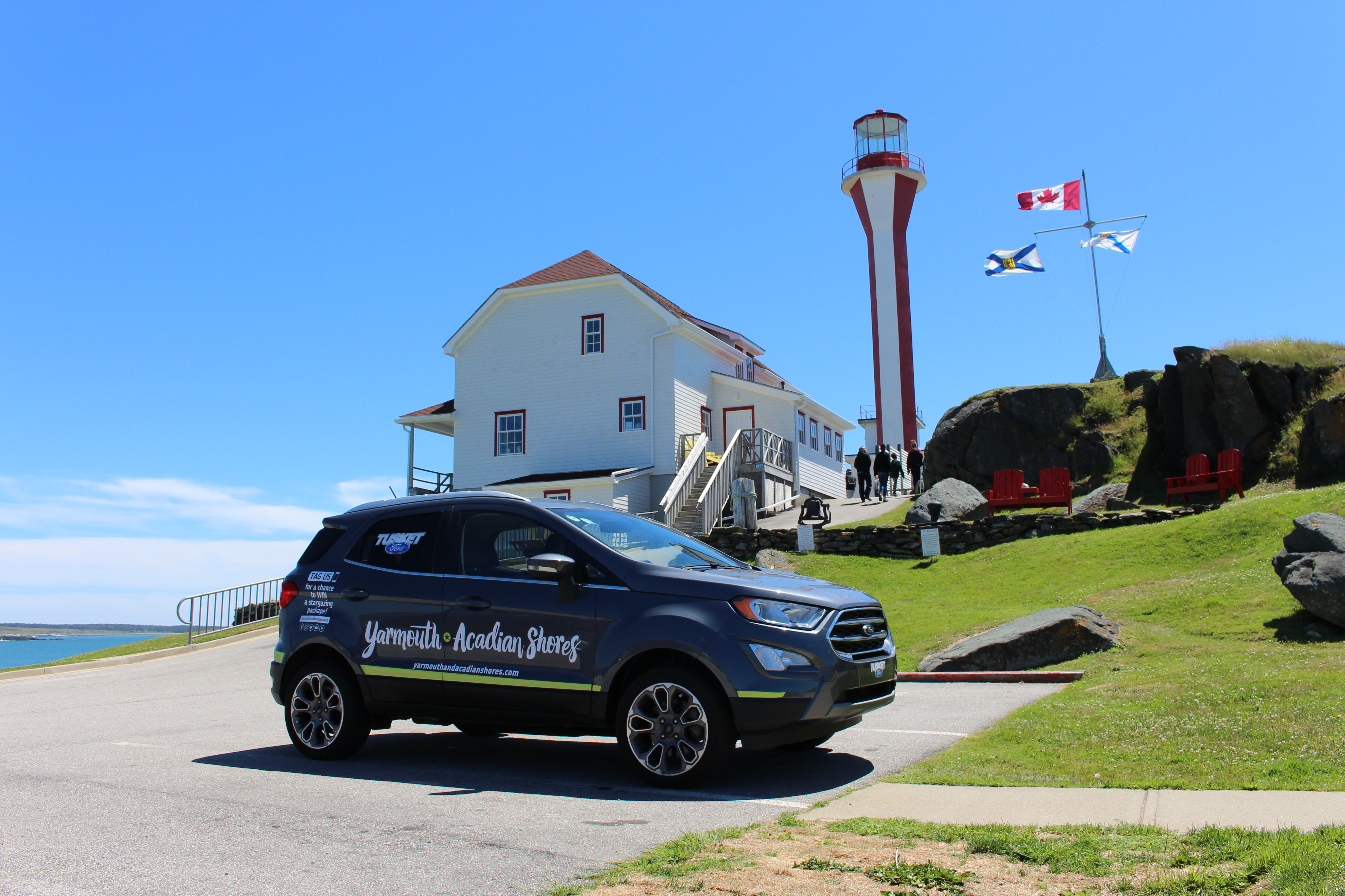 The Yarmouth & Acadian Shores Tourism Association's summer cruiser at the Cape Forchu Lightstation.
