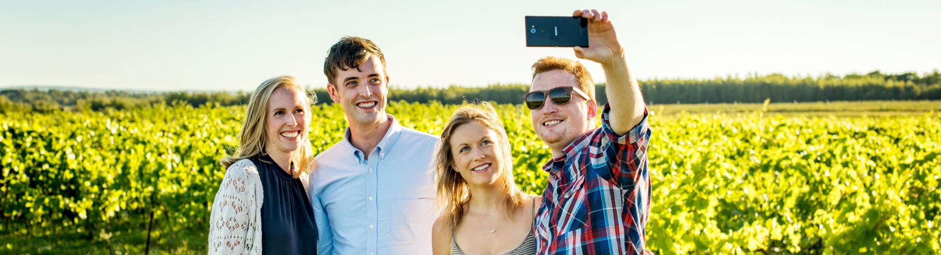 Group posing for photo at a vineyard in Nova Scotia