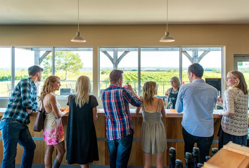 Visitors sampling wine at Blomidon Estate Winery