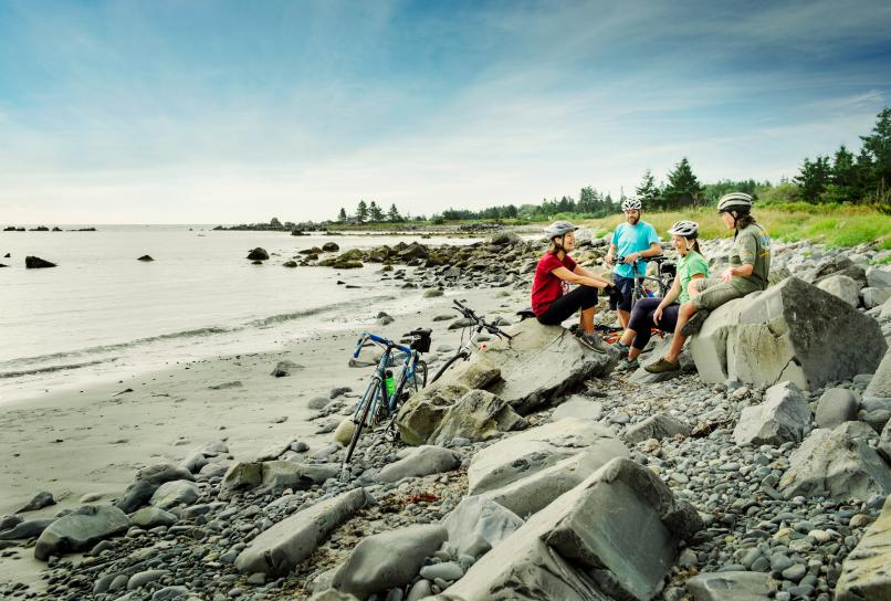 Cyclists visiting a beach on the South Shore of Nova Scotia.