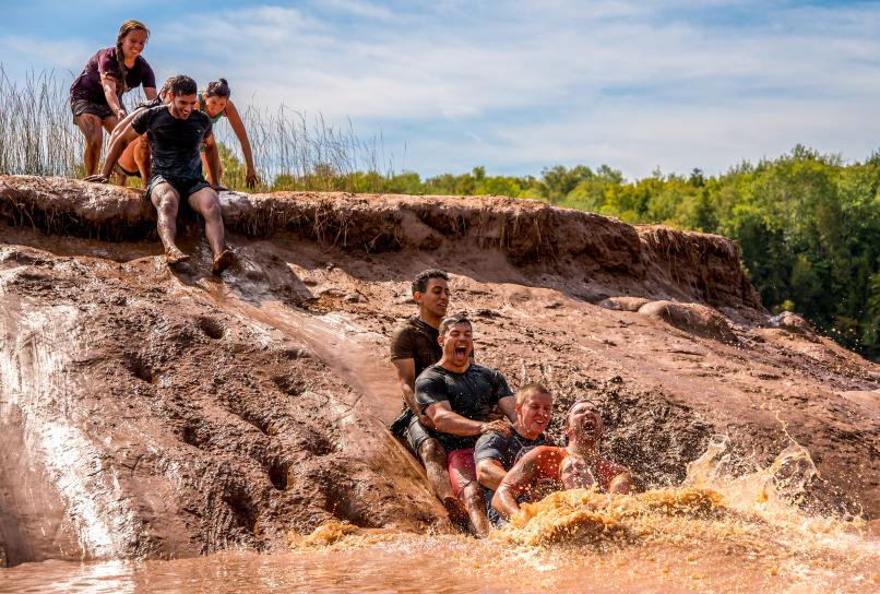 Mudsliding is part of the tidal bore rafting experience.