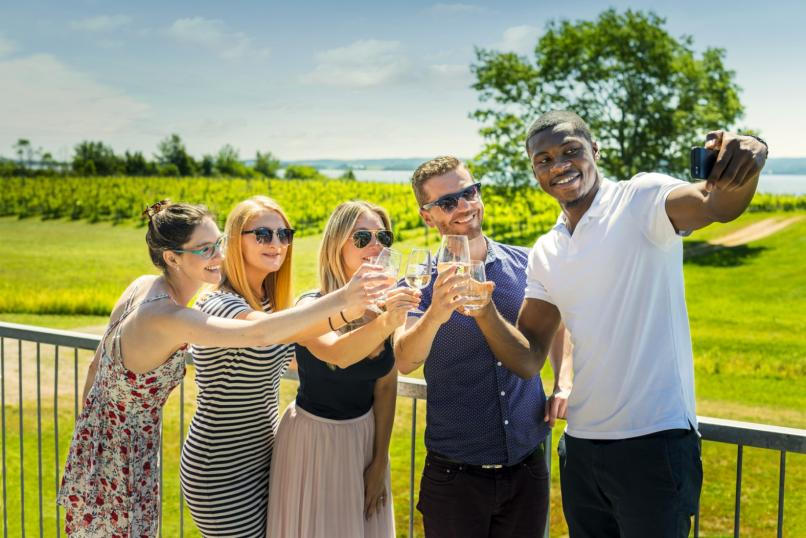 Group taking a photo at a winery