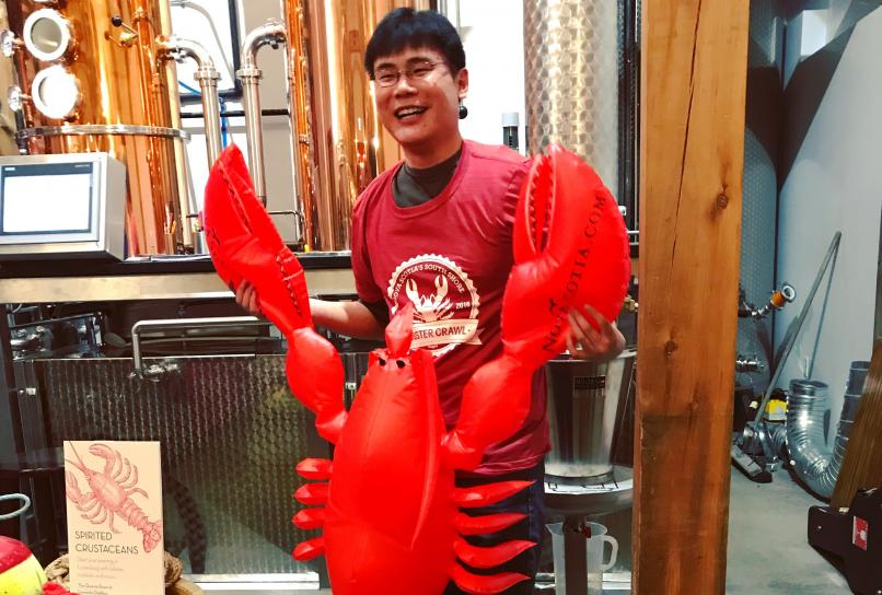 Raymond, the Travelling Foodie, with a giant lobster during the Nova Scotia Lobster Crawl