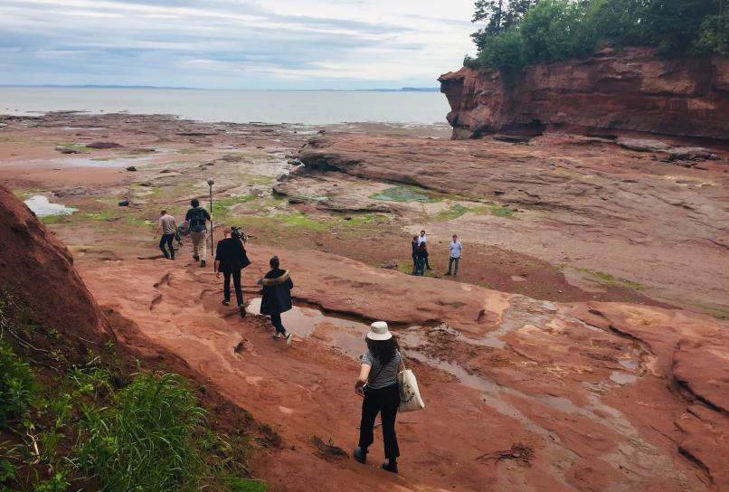 Media members explore the Bay of Fundy