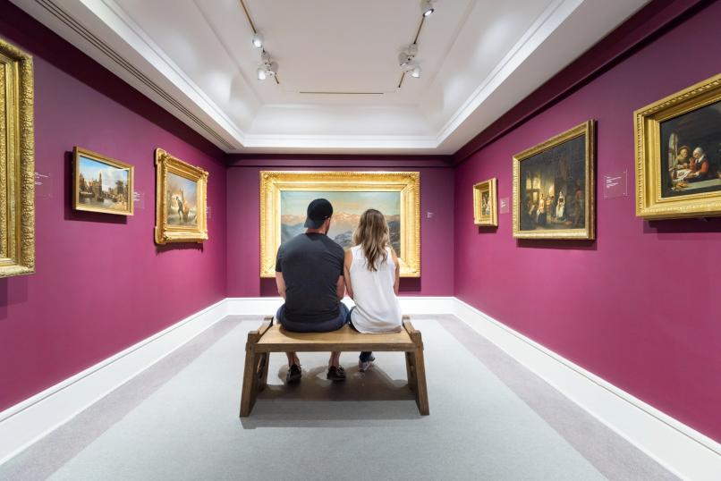 Two people viewing a painting at the Art Gallery of Nova Scotia